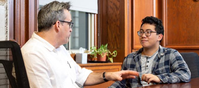 An advisor talks with a student